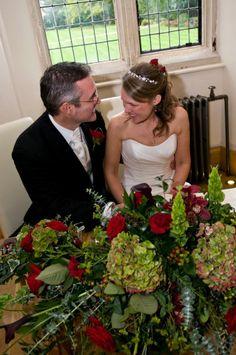 Registrar Table designs full of hydrangea and roses.  www.wildorchidweddingflowers.co.uk