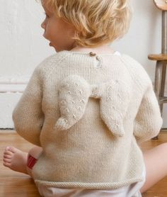 Cutest little sweater. Although small child may not think so with something sticking into their back when in car seat or pram.