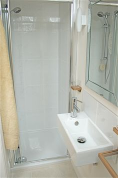 bathroom remodel ... love the shower, sink & mirror!  tiny, cute, & modern