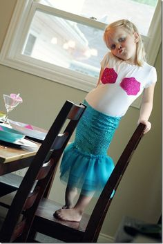 "DIY mermaid costume. Glue/sew ""shells"" onto shirt. Skirt is a sequin tube with tule sewn to the bottom. Would need to do more to the top, but other then that, love it! --for my baby girl one day"