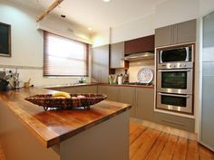 A U shaped kitchen is one of the most functional layouts in kitchen designs. A U shaped kitchen design keeps work zones compact and functional. Kitchen Designs Photos, New Kitchen Designs, Kitchen Photos, Kitchen On A Budget, Modern U Shaped Kitchens, U Shaped Kitchen With Breakfast Bar, Kitchen Interior, Kitchen Decor, Kitchen Ideas