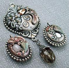 Metallic Filigree Pendants by MandarinMoon, via Flickr