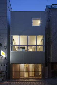 """House in Ningyo-cho / K+S Architects.  The wall is made by the plaster boards with dry joints, and painting with special coating. Floor finishing material is the cork tiles as a street outside. We can approach to the deck of the third floor, as if we walk in a street lane """"Roji"""". The upper small rooms are located to be accessible by the stairs. They feel the warm sunshine and natural breeze through the urban canyon by the roof windows. The roof terrace is so useful and precious as a private…"""