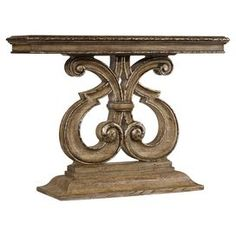 """Add an eye-catching touch to your entryway or den with this chic console table, showcasing a fleur-de-lis-inspired base and brown finish.   Product: Console tableConstruction Material: Poplar wood and oak wood veneersColor: Weathered brownFeatures: Openwork baseDimensions: 34.5"""" H x 48"""" W x 14.5"""" D"""