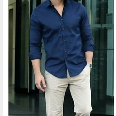 Dark blue formal shirt with cream color trouser is a perfect outfit for men