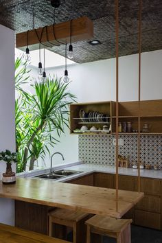 Tropical House Design With Interior Courtyard - The X House Is A Tropical Living Space Put Together By Iz Architects For A Single Female Homeowner The Home Design Was Influenced By Its Location In Danang A Central Coastal City Of Vietnam W