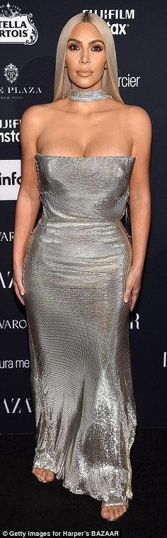 Sultry:After the awards ceremony, the 36-year-old changed into a low-cut silver Versace dress for the Harper's Bazaar Celebration of Icons By Carine Roitfeld event
