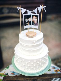 Using cute polaroids as your cake topper adds an affordable touch of personality.