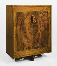 George Nakashima CABINET with client's name to the underside twice. American black walnut, Claro walnut and burled walnut, circa 1990-1991, executed by Mira Nakashima
