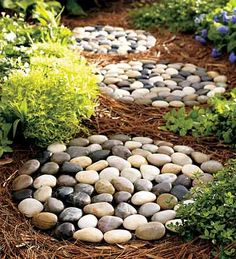 River rock stepping stones . . .these are for sale, however it's a simple DIY project for sure. Pretty cool!