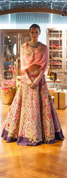 pale-pink-cape-blouse-with-heavily-embroidered-lehenga