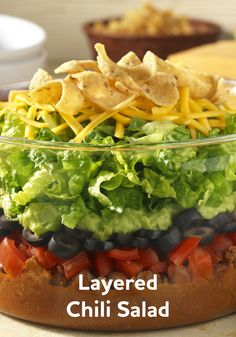 Make any dinner more delicious with this Layered Chili Salad recipe! It's easy to make and ready to eat in just 20 minutes.