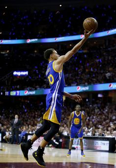 Stephen Curry #30 of the Golden State Warriors goes up against the Cleveland…