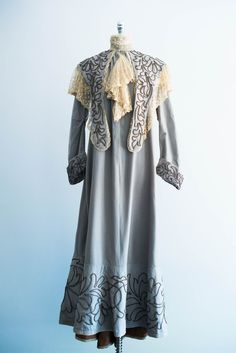 Wool Victorian walking jacket/dress in a soft gunpowder blue with soustache embroidery and embroidered lace trim on the mantle and collar.