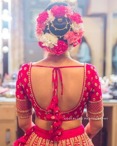 Make a style statement with this bold and big bun surrounded by florals and some gold accessory in the centre. for lehenga Bold and big floral bun<br> Blouse Back Neck Designs, Wedding Saree Blouse Designs, Simple Blouse Designs, Silk Saree Blouse Designs, Stylish Blouse Design, Wedding Sarees, Wedding Blouses, Bridal Lehenga, Make Up Braut