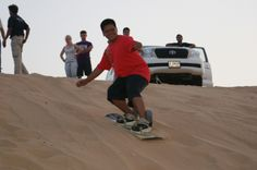 Desert sandboarding, Dubai - Desert sandboarding, Dubai: Photo of by Viator user Anonymous Dubai Tour, Book City, Travel Sights, Dubai Desert, Helicopter Tour, The Great Escape, Adventure Activities, United Arab Emirates, Day Tours