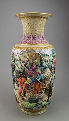 "Qing Period Chinese porcelain Vase; of baluster shape; featuring modeled war scenes and gilt decorative scrolls in relief, Guangxu mark and ""Jianding"" wax seal on base. With identification certificate from Shanghai City Museum. H: 42 cm, D: 17 cm"