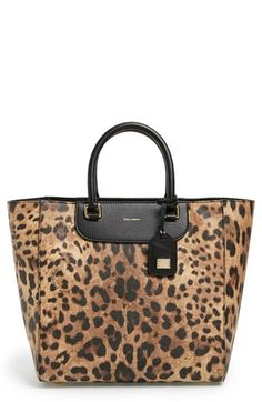 Dolce&Gabbana Medium Leopard Print Shopper Tote at Nordstrom.com. Leopard print and rich leather trim lend classic glamour to this capacious tote from Dolce&Gabbana. Slim rolled handles make for easy carrying, while a plethora of pockets will have your fashionable essentials and tech organized in a snap. Understated branding and gleaming hardware put the polish on this look.
