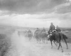 WWI, Oct 1916, Eastern Front: British mounted patrol moving off at dusk, Struma Valley. © IWM