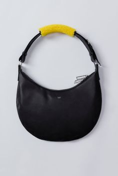 Acne Studios Bananapack dark navy is a large shoulder bag with a classic silhouette constructed of materials like soft, canvas lined calf leather paired with colourful shearling. Calf Leather, Leather Bag, Black Leather, Large Shoulder Bags, Shoulder Pads, Market Bag, Hobo Bag, Calves, Reusable Tote Bags