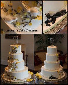 Wedding doves on yellow and grey floral wedding cake with batman peeking out the bottom.