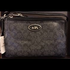 SALENWT Coach Wristlet. Very classy looking. NWT Coach Wristlet. Color is called Denim/Black. No it is not made of Denim. Comes from a smoke free home. Coach Bags Wallets