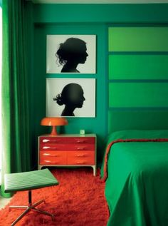 Emerald hues boldly contrast with red/orange to bring modish style to this bedroom.
