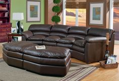 The Canyon Conversational Sofa will definitely fit the whole family for movie night! And not to mention... it's very comfortable. Available in leather or fabric. Sold at Peters Billiards in Minneapolis, MN.