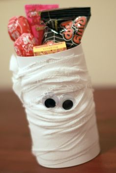 Toilet paper mummy craft :) To make them a little bigger I used the bottom part of a Water bottle. In safe key Some one Saved a huge box of them and thats one of the things I found to do with them, that way they also have a bottom, unlike a tp roll