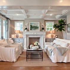 Love the matching dressers in this living room that resemble built ins.  Nice use of table lamps on each one.