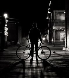 Amazing silhouette photograph of a man in the city with his bicycle. Urban Photography, Street Photography, Shadow Silhouette, Cycling Art, Urban Cycling, Fun Shots, Black And White Pictures, Black White, Great Photos