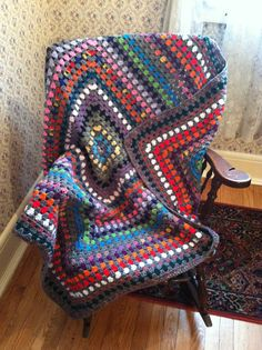 Giant granny square blanket in alternate stripes of colour and grey by peridotcrafts on Etsy