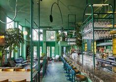 Studio Modijefsky przemienia amsterdamską kawiarnię w ogród botaniczny