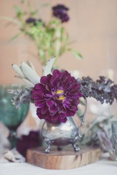 Antique silver dishes, minimal flowers, and *kale* - so unique and lovely!  Style Me Pretty | Gallery