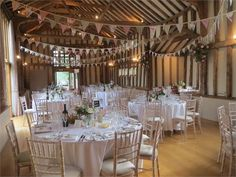 The barn looks wounderful, set with lovely summer flowers and hand made bunting.