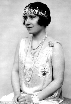 Portrait of Duchess of York - the future Queen Mother - in 1928 wearing the Lotus Flower tiara after it was made by Garrard from a Greek-style necklace given to her by her husband the future George VI