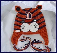 """TIGER FANS !!! DETROIT IT'S HERE!!! **TIGER HAT ..with earflaps and LOOK at the """"D""""..the patch was made by LR Embroidered Creations!! Sizes: Newborn to Adult !!  ***If your interest, please don't hesitate to contact me @Benji2@comcast.net or message me....See all my creations on fb Boutique Handmade Baby Outfits by Alex!  ~~ THANK YOU FOR LOOKING ~~"""