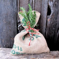 make some burlap bags for reuseable gift bags, tie with multiple torn strips of fabric