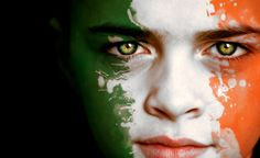 A boy with the flag of The Republic of Ireland painted on his face