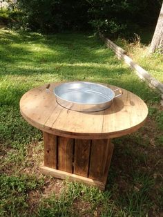 Ice bucket coffee table is great for outdoor get togethers.  The center bucket can hold a variety of drinks.  The wood can be left natural, or stained.  There is a waterproof coating sprayed on.  Item is built once it is ordered.  Please check out our facebook page for other builds we have recently completed.  www.facebook.com/akersfurniture reclaimed, wood, entertainment, back yard, backyard, bbq, barbeque, party, furniture, round, table, old, new, circle,