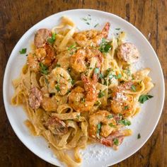 This Cajun shrimp fettuccine alfredo is packed full of flavor with a little Cajun twist. It's perfect for busy weeknights and you'll say goodbye to jarred sauces when you see how easy it is to make your own! Plus the little punch of andouille sausage really brings that Cajun flavor.