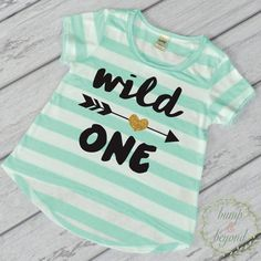 1st Birthday Girl Outfit - This adorable high-low short sleeve top makes a great birthday outfit or photo prop! It features an all-over stripe print for a fun chic look. It's made of light weight jers