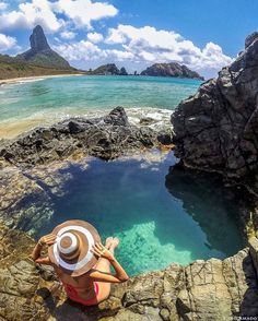 In the beautiful natural pools of Fernando de Noronha, PE, Brazil