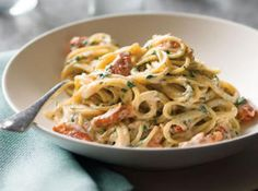 Pasta with Smoked Salmon and Sun-dried Tomatoes.  Lesa adds asparagus tips and pine nuts...Yummy!