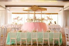 Party table with chiavari chairs from a Gold & Pastel Carousel Birthday Party at Kara's Party Ideas.