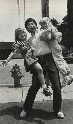 """Steven Spielberg with Drew Barrymore and Heather O'Rourke between filming """"E.T."""" and """"Poltergeist"""" ~ 1982"""