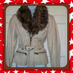 NWT !  TAN LEATHER W/FAUX FUR COLLAR, NEVER WORN , U CAN TELL (?) IT DOESNT EVEN HAVE WEAR WRINKLES IN THE JACKET ANYWHERE !!!!!                                                                                             I HAVE THE TAG ) Tan soft leather from Wilsons (got it on sale), big fur collar that detatches by button, silky snakeskin print liner, has a matching belt. Jackets & Coats