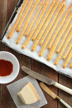 Cheese Straws are a favorite British nibble and canapé year-round, but especially welcome at Christmas and New Year's parties. The first recorded recipe is in 'Mrs Beeton's Book of Household Management' published in 1861. They are savory, crisp and easy to make:  lard, butter, flour, cheese and a spice such as nutmeg or Cayenne pepper. There are many different recipes today.