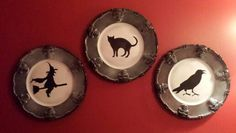 Dollar store plates spray painted with a little white and silhouette cutouts.