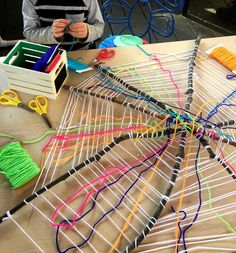 Lots of folks wondered about our spider weaving web. - Miss @lololeopard created this web with sticks and yarn for a game at our fall festival. I loved the web so much that I wanted to find other uses. So this week we have been gradually introducing the weaving process to our students using the web as our base. #preschool #spiderweb #weavingwithkids #finemotorskills #momsoninstagram